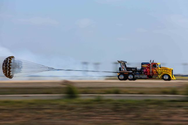 Shockwave, the world's fastest truch deploys it's parachutes to stop after hitting over 340 mph at the 2015 Miramar Air Show. http://flashfirejettrucks.com