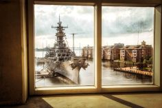 The USS Wisconsin (BB-64) as seen through the window of a parking garage in Norfolk, Virginia.