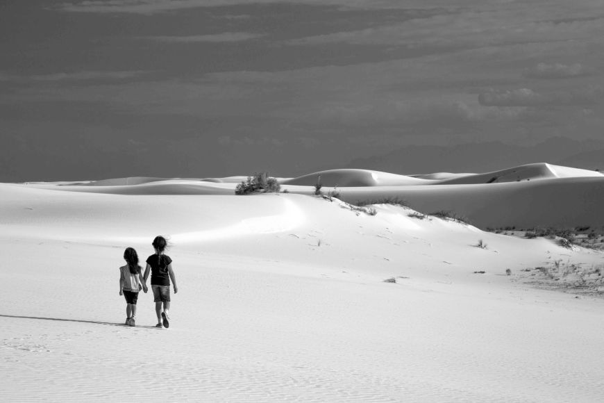 My little girls walking at White Sands National Monument.